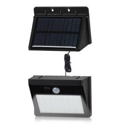 Foco solar de pared c/ sonsor y panel desmontable 28 leds.