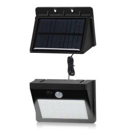 Foco solar de pared c/ sonsor y panel desmontable 28 leds.
